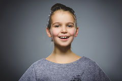 Happy girl. Closeup Portrait handsome child smiling isolated on grey royalty free stock photo