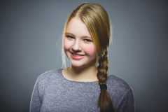 Happy girl. Closeup Portrait handsome child smiling isolated on grey stock photography