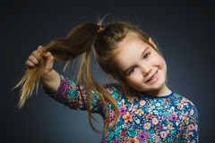Happy girl. Closeup Portrait handsome child smiling isolated on grey Royalty Free Stock Images