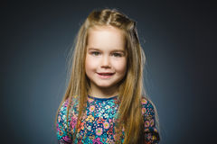 Happy girl. Closeup Portrait handsome child smiling isolated on grey Stock Photos