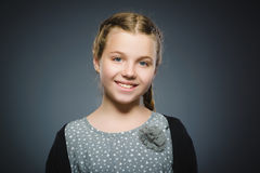 Happy girl. Closeup Portrait handsome child smiling isolated on grey stock photo
