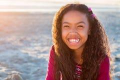 Happy girl closeup portrait outdoors. Happy girl with long hair, closeup portrait outdoors smiling royalty free stock photos