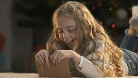 Happy girl closing envelope with secret letter to Santa Claus, childhood, magic. Stock footage stock video
