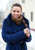 Happy girl in coat in winter Stock Image