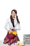 Happy girl collecting books Royalty Free Stock Photos