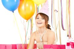 Happy girl with color balloons and gift bags Stock Images