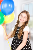 Happy girl with colorful balloons Stock Photos