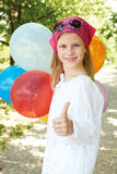 Happy girl with colorful balloons. Happy girl is in a amusement park with colorful balloons Stock Photos