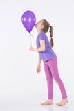 Happy girl with colorful balloons Stock Images