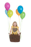 Happy girl with colorful balloons. Happy kid on hot air balloon Royalty Free Stock Photo