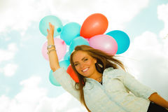 Happy girl with colorful balloons outdoors Stock Photos
