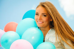 Happy girl with colorful balloons outdoors Stock Photo