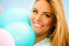 Happy girl with colorful balloons outdoors Royalty Free Stock Image