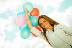 Happy girl with colorful balloons outdoors Royalty Free Stock Images