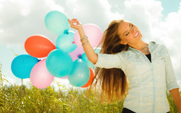 Happy girl with colorful balloons outdoors Stock Images