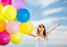Happy girl with colorful balloons. Summer holidays, celebration, family, children and people concept - happy girl with colorful balloons Royalty Free Stock Images