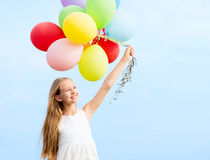 Happy girl with colorful balloons Stock Photo