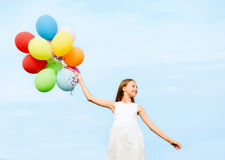 Happy girl with colorful balloons. Summer holidays, celebration, family, children and people concept - happy girl with colorful balloons Stock Photo
