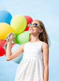 Happy girl with colorful balloons Royalty Free Stock Photography
