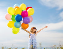 Happy girl with colorful balloons Stock Photography