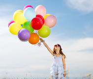 Happy girl with colorful balloons. Summer holidays, celebration, family, children and people concept - happy girl with colorful balloons Royalty Free Stock Photography