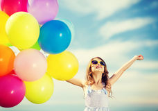 Happy girl with colorful balloons Stock Image