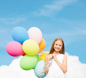 Happy girl with colorful balloons. Summer holidays, celebration, family, children and people concept - happy girl with colorful balloons Stock Image