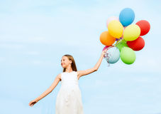 Happy girl with colorful balloons Royalty Free Stock Images