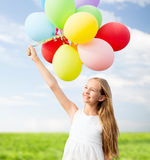 Happy girl with colorful balloons Royalty Free Stock Photo