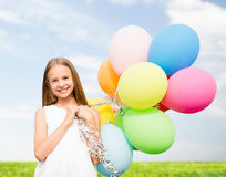 Happy girl with colorful balloons. Summer holidays, celebration, family, children and people concept - happy girl with colorful balloons Stock Photos