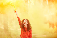 Happy girl with colorful smoke bomb Royalty Free Stock Images