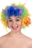 Happy girl in a colorful wig Stock Photos