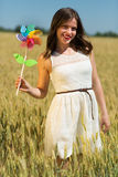 Happy girl with a colorful windmill Stock Photo