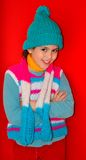 Happy girl in colorful wool knits Stock Image