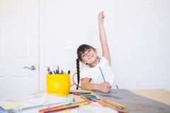 Happy girl doing art work royalty free stock images
