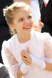 Happy girl in communion dress. Happy young blond girl in white holy communion dress Royalty Free Stock Image