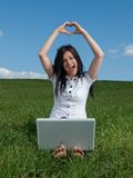 Happy girl with a computer. Pictures from photo shoot - a woman with a computer in nature - Slovakia 2012 Royalty Free Stock Image
