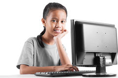 Happy girl with a computer Stock Images
