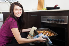 Happy girl with cooked  pie Royalty Free Stock Photo