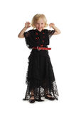 Happy girl in costume of a witch Stock Images