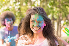 Happy girl covered in powder paint Royalty Free Stock Images