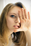 Happy girl covers her hand eye Royalty Free Stock Photography