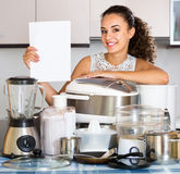 Happy girl with culinary devices and paper Royalty Free Stock Images