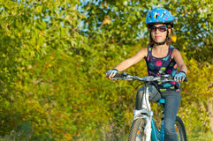 Happy girl cycling outdoors Royalty Free Stock Photography