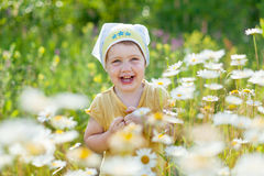 Happy girl in daisy meadow Royalty Free Stock Image