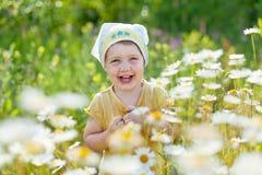 Happy girl in daisy meadow. Happy baby girl in daisy meadow Royalty Free Stock Image
