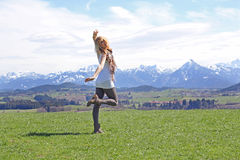 The happy girl. A happy girl dances on that would point before the mountains Royalty Free Stock Photos