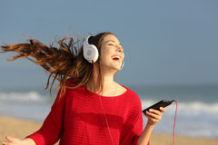 Happy girl dancing and listening music royalty free stock images