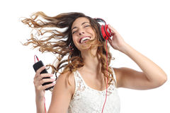 Happy girl dancing and listening to the music. Isolated on a white background Royalty Free Stock Photo