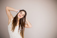 Happy girl dancing and listening to the music isolated. On a white background stock photos